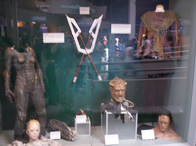 Star Trek: The Exhibition display case with a Borg Queen dummy and various alien props, costumes, and makeup samples
