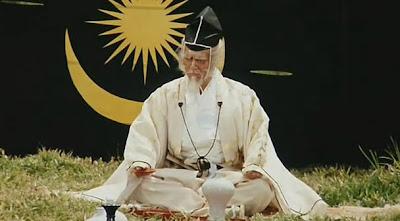Ran Hidetora sitting