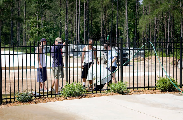 Counselors getting camp set up for summer camp for at-risk kids from Atlanta