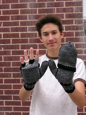 boy with mittens on