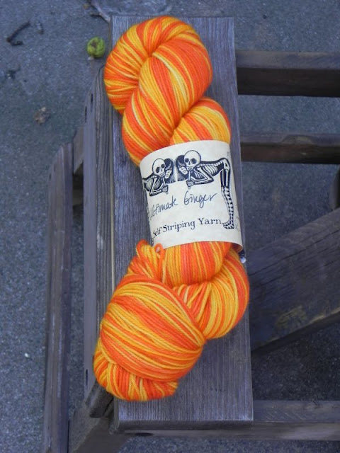 skein of orange and yellow stripey yarn