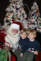 twin boys picture with Santa