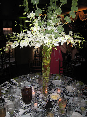 Beautiful Tall Centerpieces with white Orchids and bells of Ireland