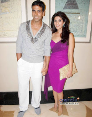 Akshay Kumar with his sexy wife Twinkle Khanna standing on party photo