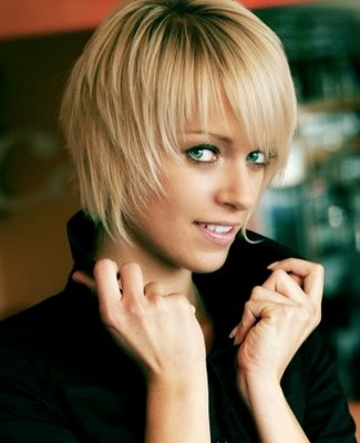 Sleek, long layered hair style with choppy bangs. choppy layers hairstyles.