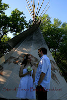 couple getting married in front of the tipi