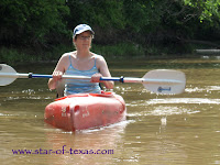 lady in a kayak on the Pecan bayou