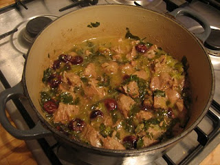slow-cooked lamb with spring onions, cherries and lemon