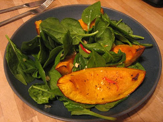 roast squash, chilli and spinach salad with peanut and ginger dressing