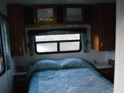center view of the bedroom showing the back window