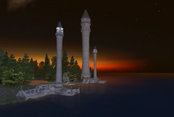 elven towers shilouetted against the sunset
