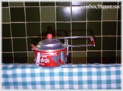 Panelinha de pressão feita de lata de coca-cola