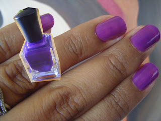 At-home manicure with violet nail polish