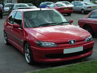 Peugeot 306 Car picture description: A red 306 Peugeot car.