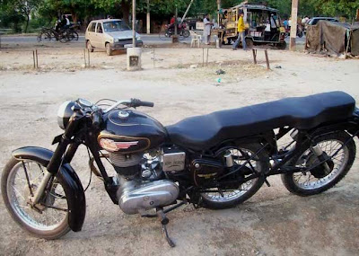 three-wheeled Royal Enfield.