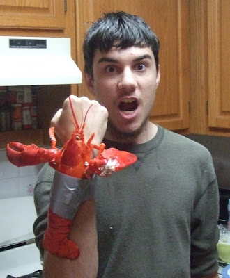 Photograph of a brilliant young man with a lobster duct-taped to his forearm
