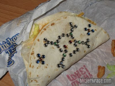 A photograph of a chicken soft taco that has decorative gems added to it with a bedazzler.