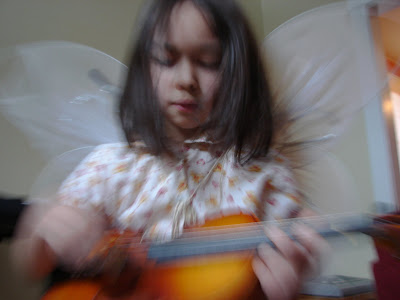 Georgia with her Violin (backwards motion blur)