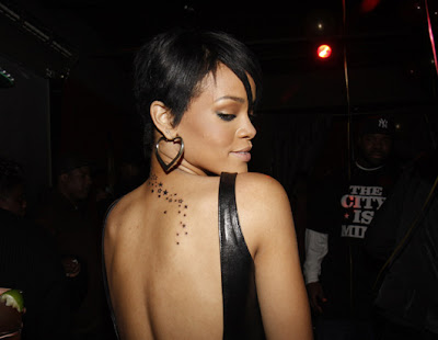Secret weapon: Rihanna unveils controversial new gun tattoo