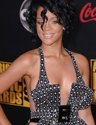 rihanna red hair curly. The short curls can make an
