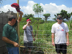 Calvary team building a barbed wire fence for one of our single moms in Bogue