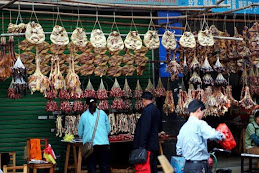 Ready-cooked dogs on sale at Guangdong market