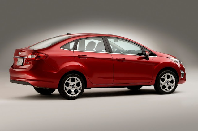 Side view of red 2011 Ford Fiesta sedan