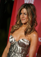 Jennifer Aniston with her tits pushed up to the max