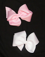 These bows are made out of 2 1/4 inch ribbon. I have brown, baby pink, white, and black.