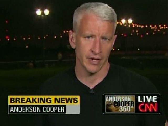 Anderson cooper flexing