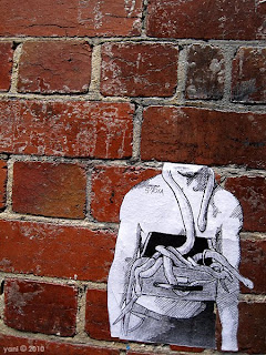 headless street art paste up