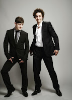 iwan rheon (left) as simon bellamy and robert sheehan (right) as nathan young