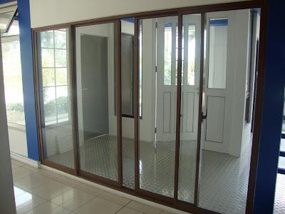 Pintu Alumuniumm yang cara membukanya dengan digeser dan menggunakan
