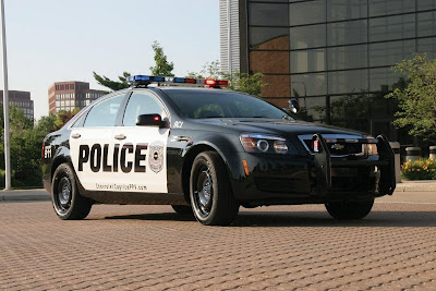 GM equipped Chevrolet Caprise under police car