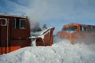 Plow meets locomotive