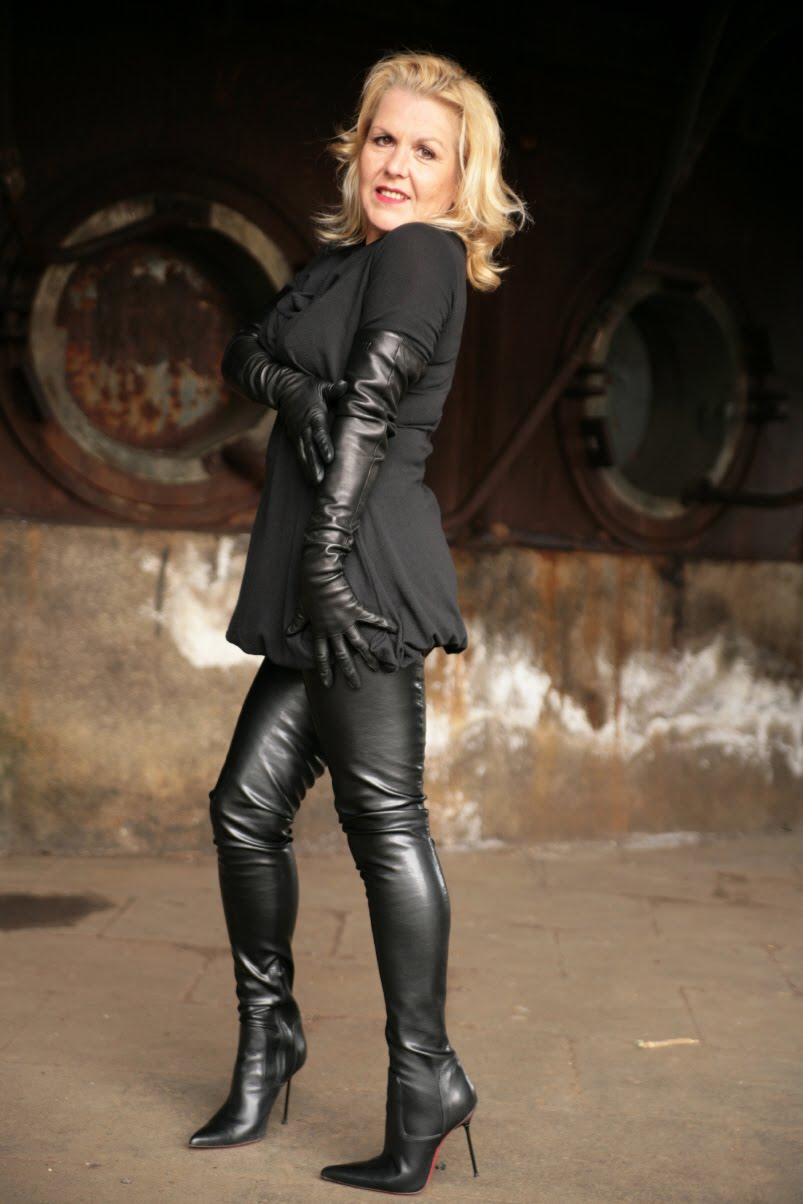 Mistress Vanessa in leather crotch high boots and opera gloves