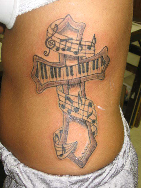 Memorial Cross Tattoos. music cross tattoo,