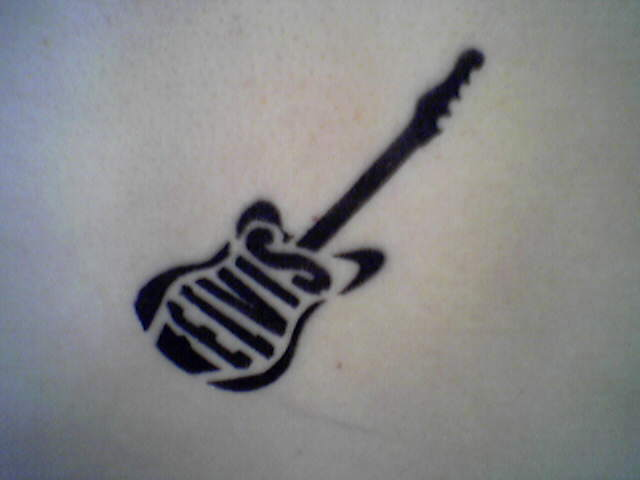 The last of my Elvis Tattoo Designs is this little guitar tattoo with Elvis