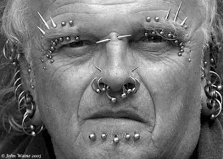 extreme piercings elderly man