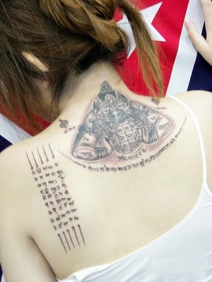 Symbol Letter Tattoo designs With The Sculpture