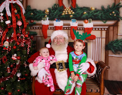 Sean and Evie with Santa