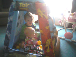 Playing together in their new ball pit