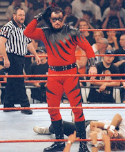 kane takes off this mask and its the undertaker