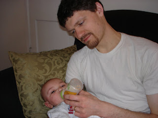 hubby feeding the baby a bottle