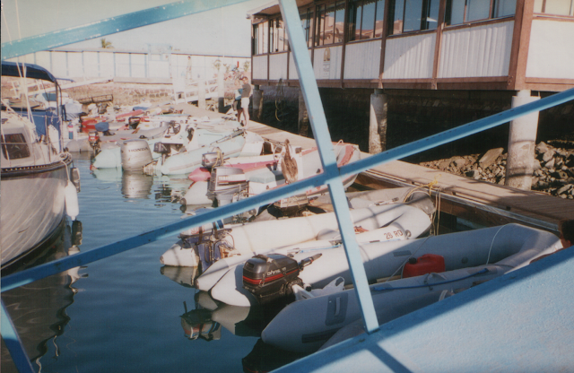 Inflatable dinghies lined up at dinghy dock in Mexico