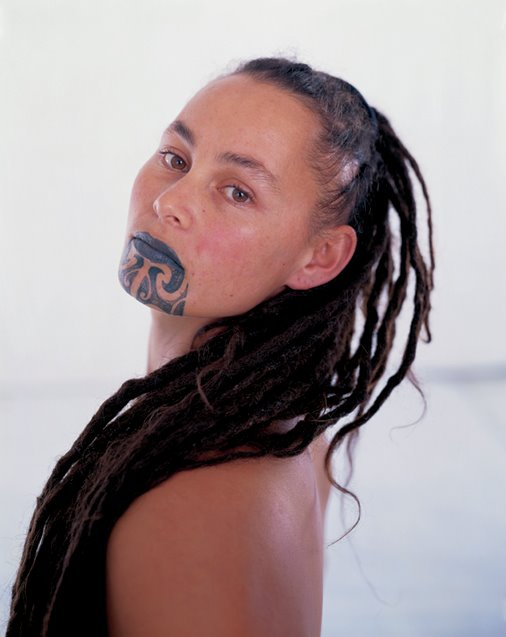Crowning her lips and chin with all its glory is a moko tattoo.