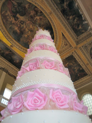 Here is Melissa's wedding cake competing with Rubens ceiling in the
