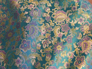 Turquoise with lavendar flowers brocade fabric