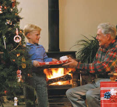 NAMC Montessori christmas seasonal activities reading boy giving gift to grandpa