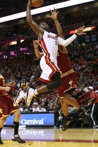 dwyane wade posterizes anderson varejao. D-Wade with the and-1 dunk